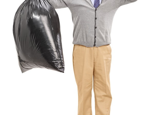 31474089 - full length portrait of a senior holding a stinky garbage bag isolated on white