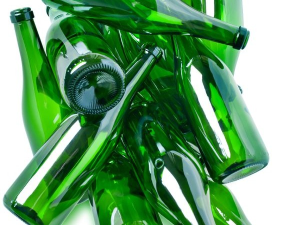 8957462 - heap of green glass bottles ready for recycling isolated over white background