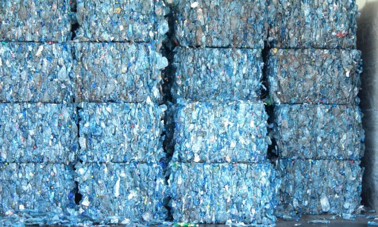 16323083 - bales of blue plastic bottles stacked at an undisclosed recycling facility  the plastic is gathered by color and type to be recycled