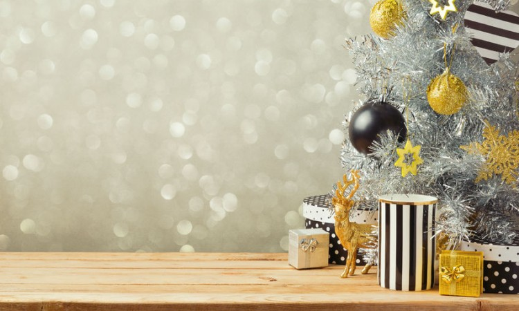 45721300 - christmas background with christmas tree on wooden table. black, golden and silver ornaments